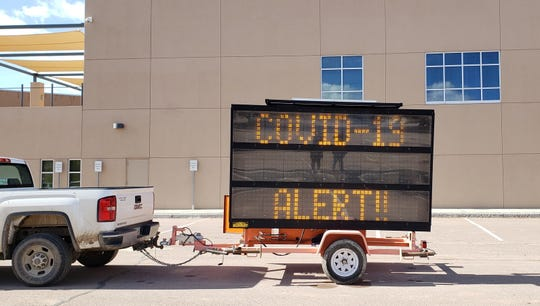 The Navajo Division of Transportation placed electronic traffic signs in Many Farms and Mexican Water, both in Arizona, on March 20. Each sign alerts community members about the public health state of emergency for COVID-19 and encourages people to stay home.
