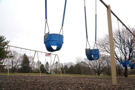 Empty swing sets at South Lyon's McHattie Park on March 20, 2020 attest to the fact that people are staying away during its close due to the COVID-19 situation.
