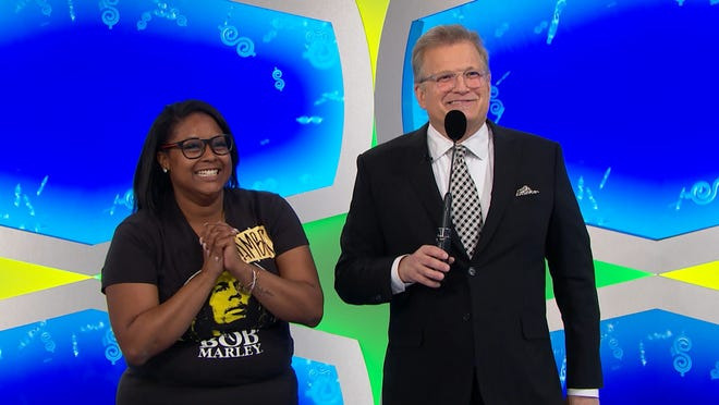 "Redford resident Amber Barnette with ""The Price is Right"" host Drew Carey."