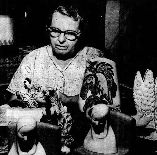 Ophelia Pitre Lafleur with some of her ceramic pieces in 1960.