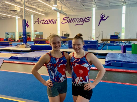 Riley McCusker, left, and Jade Carey stand together during a practice session.