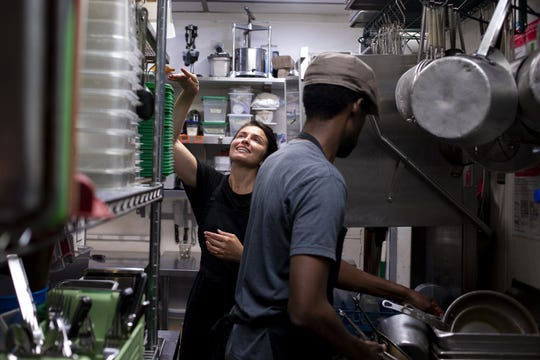 Chef Danielle Leoni and Dwayne Allen clean the kitchen after the Breadfruit and Rum Bar's final service on March 19, 2020, in Phoenix. Leoni and Allen closed the downtown restaurant they opened in 2008 due to the COVID-19 pandemic and don't know if or when they will be able to reopen.