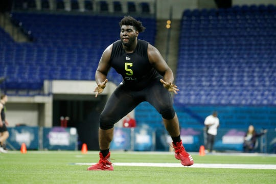 Louisville Cardinals offensive lineman Mekhi Becton is a trendy pick for the Arizona Cardinals in 2020 NFL mock draft projections after the DeAndre Hopkins trade.