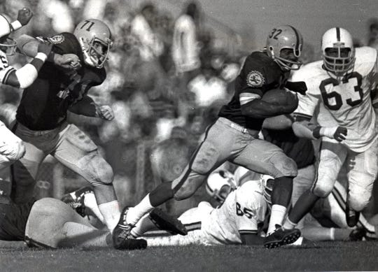 Former Arizona State running back Ben Malone (32) died Thursday at age 68. He is second in school single game rushing (250 yards) and a member of the ASU Athletic Hall of Fame.