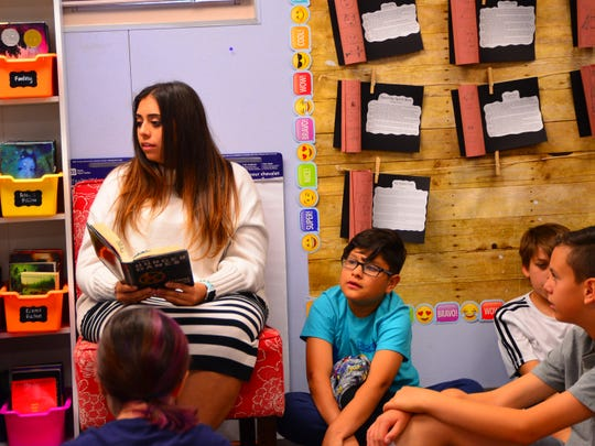 Sixth graders listen intently as Elsa Dean reads a chapter of 'The Hunger Games' on Thursday, March 5, 2020 at Whittier Elementary in Mesa.