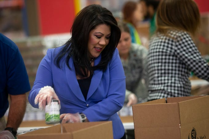 Arizona state Treasurer Kimberly Yee volunteers at St. Mary's Food Bank in Phoenix on March 20, 2020.