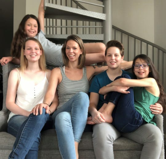 Amanda Kitchen and her four children. Order, from left to right: Matty (top), Jane, Amanda, Paige, Charly.