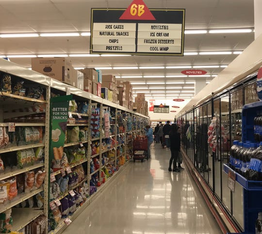 Aisles in Redner's Warehouse Market in Palmyra were fairly crowded for early on a Friday afternoon. Workers at Redner's are getting a raise as they deal with overwhelming demand due to the new coronavirus.
