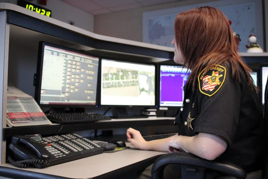Deputy Heather Moss, a dispatcher at the Ottawa County Sheriff's Office, responds to emergency calls county-wide from the communications center within the department at the courthouse. Maintaining the integrity of the communications center during the coronavirus outbreak is vital for first responders.