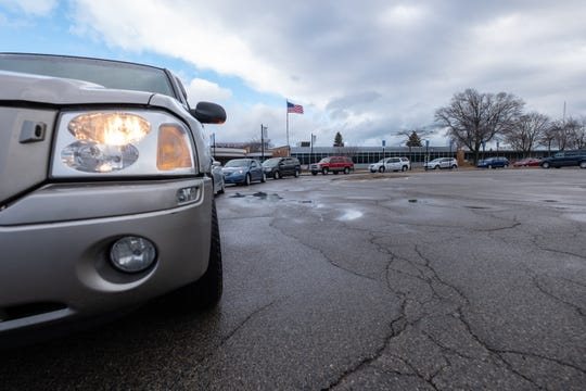 Cars line up to receive meals Friday, March 20, 2020, at Port Huron High School. Due to a high volume of people coming for donations, the school set up a second drop-off point.
