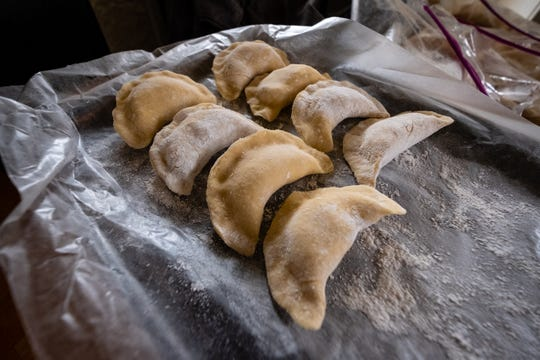 Pierogi stuffed with cheese and potatoes are arranged on a baking sheet in the kitchen of Taylar Sauer's Port Huron home.
