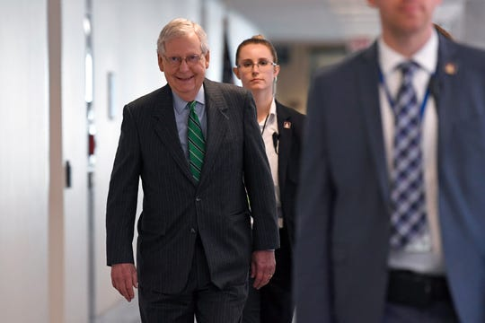 Senate Majority Leader Mitch McConnell of Ky., walk to attend a Republican policy lunch on Capitol Hill in Washington, Thursday, March 19, 2020. (AP Photo/Susan Walsh)