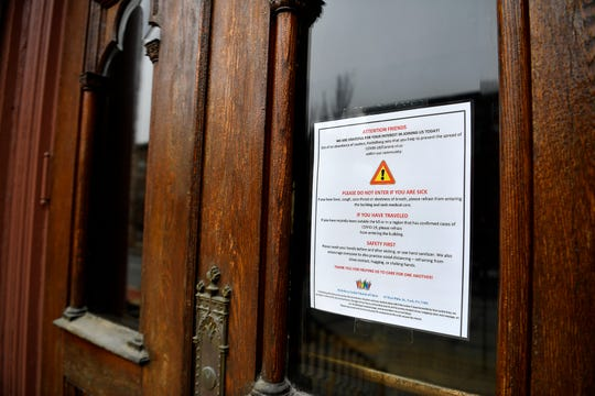 A sign on the door of Heidleberg United Church of Christ on W. Philadelphia Street provides guidelines for visitors due to the pandemic, Thursday, March 19, 2020.