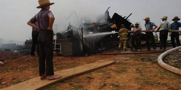 Members of the Amish community look on - and some help out - in a fire in Lower Chanceford Township in 2002.