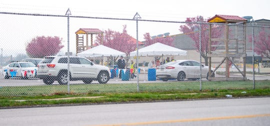 Cars line up for occupants to be tested for COVID-19 at the York Expo Center on Friday.