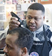 Willie Lightfoot at his barber shop on Jefferson Ave. in Rochester says closing is the right thing to do.