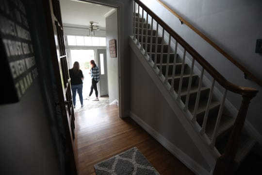 The Bethany House, a shelter for women and women and children, is closing temporarily in a few days because of workers having to stay home.  Meg Burkhard, director of Bethany House, and Sophie Schmolz, talk with someone who walked up on Friday, March 20, 2020 looking for baby food and diapers.