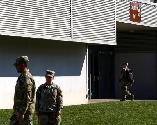 A member of the National Guard enters Columbia Hall at the Oregon State Fair & Exposition Center in Salem on March 20, 2020.