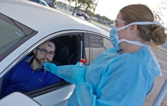 Jose Losoya, left, and Chelsea Stroud, run through a drill before opening the drive thru coronavirus testing site at Shannon Medical Center on Friday, March 20, 2020. Losoya was playing the role of a patient for purposes of the drill and had not been identified as a patient requiring further testing for coronavirus.