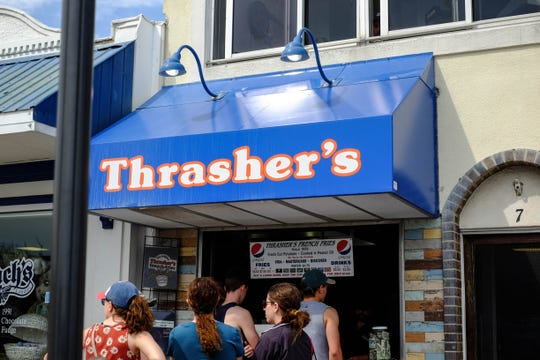 Thrasher's in Rehoboth Beach had a long line on Friday, March 20, 2020, amidst the coronavirus pandemic and despite some officials asking people to stay at home.