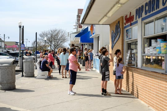 Families, retirees, locals and out-of-state visitors flocked to Rehoboth Beach Friday, March 2020, amidst the coronavirus pandemic and despite some officials asking people to stay at home. Some beach goers said they practiced social distancing to stay safe while enjoying the sun.