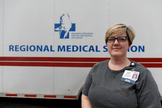 Dr. Sarah Arnett, vice president of Patient Care Services and chief nursing officer at Peninsula Regional Medical Center, posed near the new portable hospital in Salisbury on March 20, 2020.
