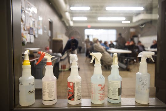 Bottles of cleaner sit on a window seal on Thursday, March 19, 2020 at the Bishop Dudley Hospitality House in Sioux Falls. The shelter has implemented hand washing stations near the front entrance and is increasing their sanitization in response to the coronavirus.
