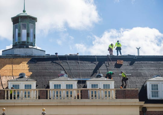 Workers install a new roof on Lee Hall at FAMU, Friday, March 20, 2020.