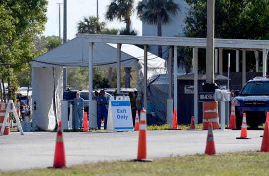Cleveland Clinic Indian River Hospital sets up a mobile testing area outside the hospital Friday, March 20, 2020, along 37th Street. Testing by appointment only is expected to begin this week.