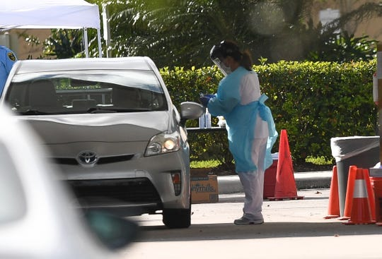 Cleveland Clinic Tradition Hospital begins drive-thru testing in the parking lot outside the hospital Friday, March 20, 2020, in western Port St. Lucie. The service is by appointment only, but anyone who is interested must call 772-419-3360 to be screened over the phone and possibly scheduled.
