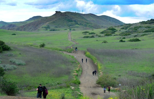 Hikers kept to their own groups and their distance from others at Wildwood Regional Park Friday in Thousand Oaks. The latest county order recognizes residents' need to exercise outdoors so long as distance is kept.