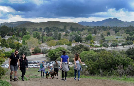 This March 2020 photo shows hikers and dog walkers get fresh air at Wildwood Park in Thousand Oaks.