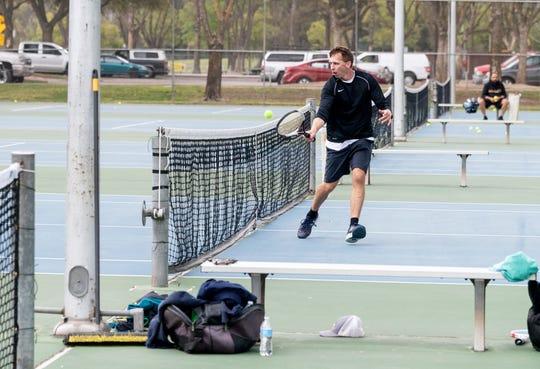 Travis Gormley plays tennis at Plaza Park on Thursday, March 19, 2020.