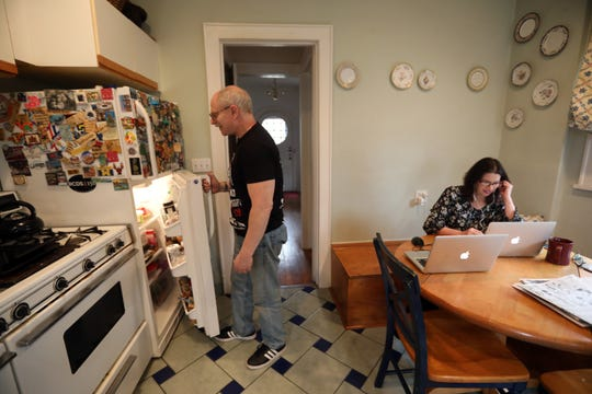 Judy Herbst, director of marketing for Worthy.com, an online auction house, works from home in Larchmont, NY amid the coronavirus outbreak March 20, 2020. Herbst is still adapting to working from home with her husband, Robert Herbst, who also works from home and often interrupts her while she's on a conference call.