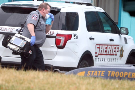 An EMStar paramedic adjust his facemask as he respond to a call where the patient had symptoms of the Coronavirus in the town of Southeast March 20, 2020.