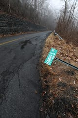 Hawkes Ave. street sign is down at Spring Valley Road in New Castle March 20, 2020. The New Castle part of the road is in bad shape compared to the section in Ossining.