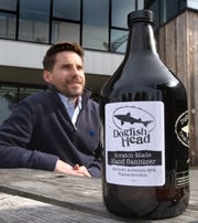 Dr. Paul Pulchny volunteered his time to scan Dogfish Head Brewery workers and visitors for any signs of virus on Friday.