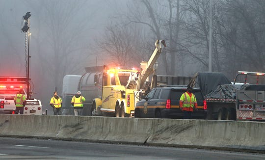 Workers clean up an early-morning accident scene on I-95 that forced the closure of the northbound lanes in the area of Churchmans Road Friday morning, snarling commutes.