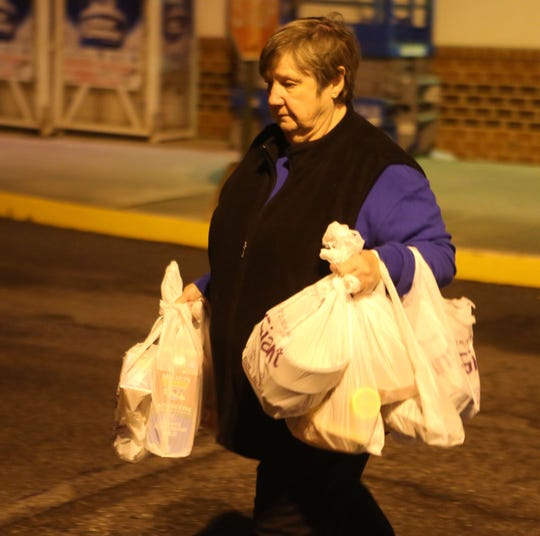 A shopper leaves the Giant Food Store in Bear Friday morning.