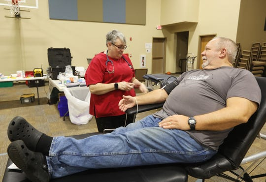 Phlebotomist Susan Ross gets ready to draw blood from Bob Rector during a blood drive at Meadow View Church of Christ in Frazeysburg on Friday. There is a critical shortage of blood supplies, and the Red Cross is seeking not only donors but places to hold blood drives after blood donation drives were canceled across the state due to the coronavirus pandemic.
