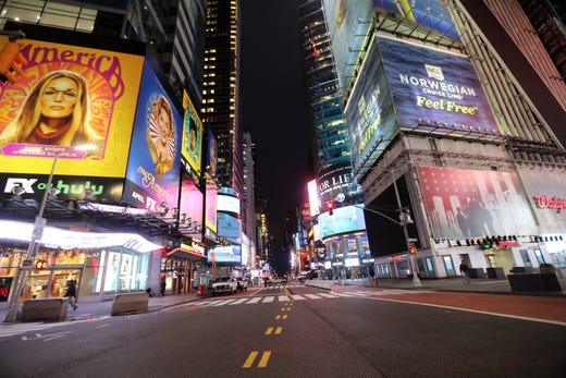 The intersection at 42nd St. & 7th Ave. in the Times Square area of New York City is almost completely free of people on March 19, 2020.