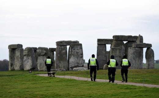 Security guards patrol around closed Stonehenge on March 20, 2020 in Amesbury, United Kingdom. English Heritage, which manages the site said, Our first priority is the health and wellbeing of all visitors, volunteers and staff, and we hope you can understand why we have taken this unprecedented step,