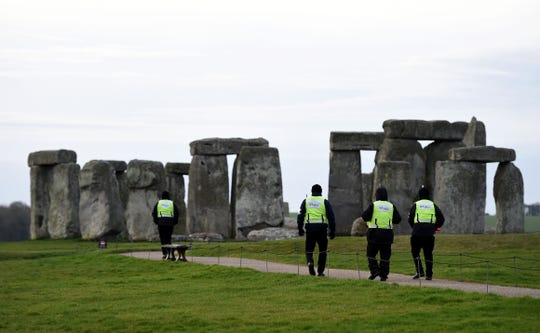 """Security guards patrol around closed Stonehenge on March 20, 2020 in Amesbury, United Kingdom. English Heritage, which manages the site said, Our first priority is the health and wellbeing of all visitors, volunteers and staff, and we hope you can understand why we have taken this unprecedented step,"""" it said. """"We appreciate this is a very important time for druids, pagans and other spiritual people and hope you will still be able to celebrate the spring equinox in your own special way. English Heritage said it would """"continue to plan for the summer solstice in the hope it will still take place""""."""