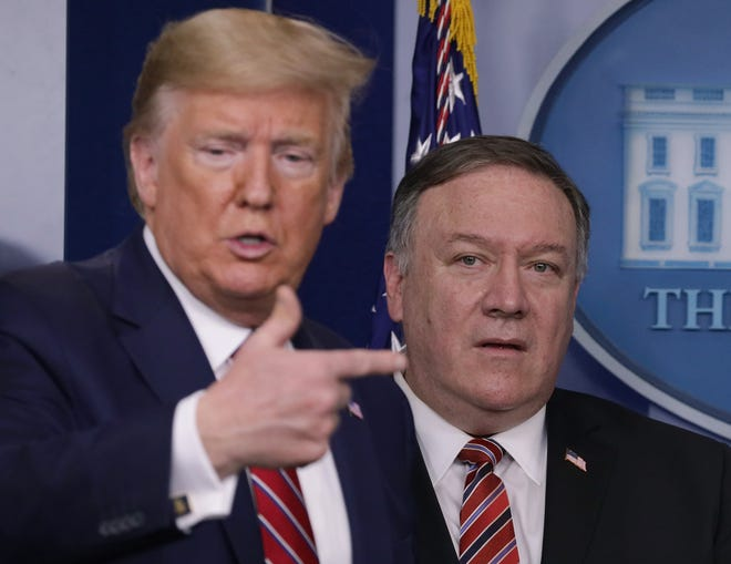 President Donald Trump speaks at the White House while flanked by Secretary of State Mike Pompeo during a briefing on the latest development of the coronavirus outbreak in the U.S.