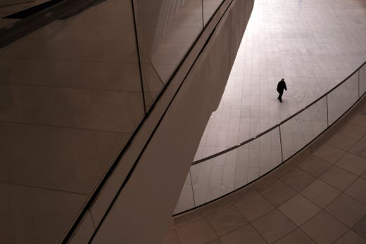 A man walks through a nearly empty Oculus transportation hub in lower Manhattan on March 20, 2020 in New York City.