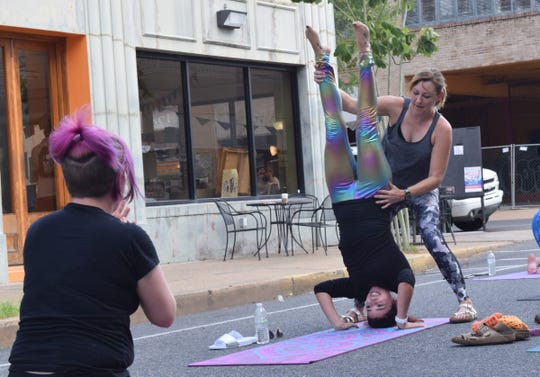 """We hope that we can foster a little peace and grounding in our community,"" said Shannon Thomas (far right), a massage therapist and yoga instructor, and co-owner of LUX Studios. Thomas is hosting free yoga classes on Facebook Live at 9 a.m. Monday through Friday."