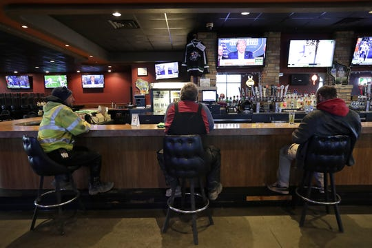 On Monday, businesses like The StoneYard on Appleton's north side could remain open if they allowed space between tables and bar stools. But on Tuesday, the state said restaurants had to close their indoor dining rooms and bars, but could continue to offer carry-out and delivery.