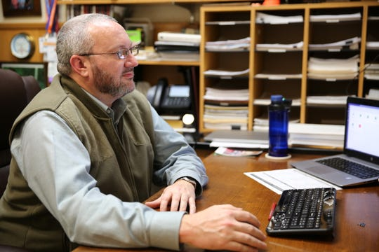 Joel Brant, chair of McMurry University's biology department, prepares for taking his class online starting Monday. As a science professor, Brant worried laboratory and practical science would suffer in an online-only setting.