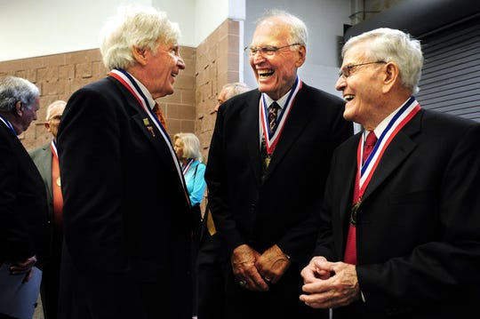 Big Country Athletic Hall of Fame inductees, from left, Dean Smith, Andy Malone and Ray Overton share a laugh before introductions at the May 7, 2012, ceremony in Abilene.