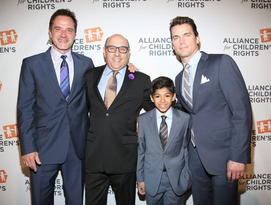 From left, Tim DeKay, Willie Garson, Nathen Garson, and Matt Bomer arrive at the 22nd annual Alliance for Children's Rights Dinner at The Beverly Hilton Hotel.